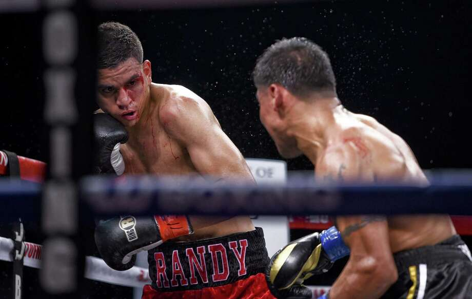 Laredo's Victor Rosas, left, handed Randy Moreno just his second loss in 14 career fights in the main event of Summer Brawl 2018 at Sames Auto Arena Friday night. Photo: Danny Zaragoza /Laredo Morning Times / Laredo Morning Times