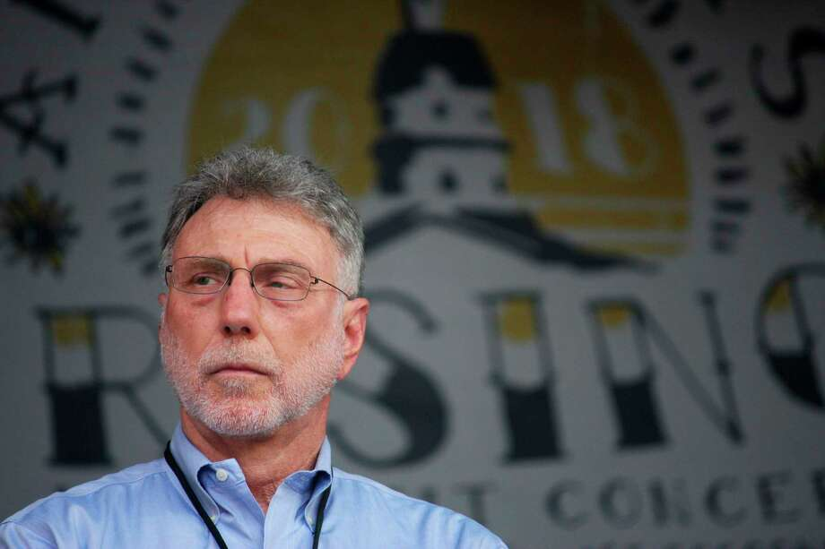 Martin Baron, executive editor of The Washington Post, stands on stage during a benefit concert in Annapolis, Md., on Saturday, July 28, 2018, to honor the five Capital Gazette employees killed in a shooting at their newsroom in June. Photo: Brian Witte / ap