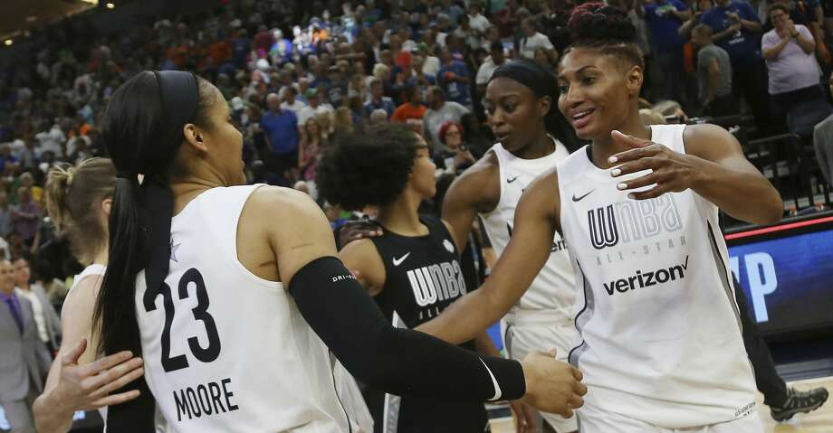 Team Candace Parker's Maya Moore, left, and Angel McCoughtry, right, celebrate after their team won 119-112 against Team Delle Donne in the WNBA All-Star basketball game Saturday, July 28, 2018 in Minneapolis. (AP Photo/Stacy Bengs) Photo: Stacy Bengs/Associated Press