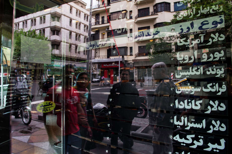 "On May 9, 2018 commuters in Tehran pass a closed bureau de change office. Photo: Bloomberg Photo By Ali Mohammadi. / © 201<div class=""e3lan e3lan-in-post1""><script async src=""//pagead2.googlesyndication.com/pagead/js/adsbygoogle.js""></script>