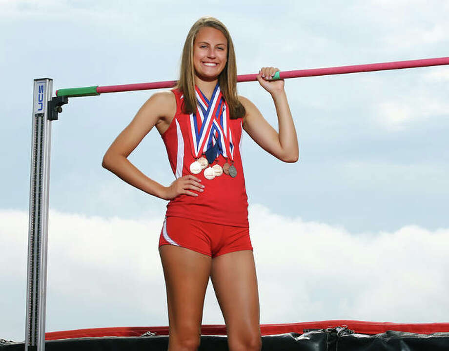 Alton's Katie Mans earned a state medal in the high jump as a senior to become the Redbirds' first four-year medalist and earn 2018 Telegraph Girls Track Athlete of the Year honors. The Illinois recruit also won the award last year. Photo: 