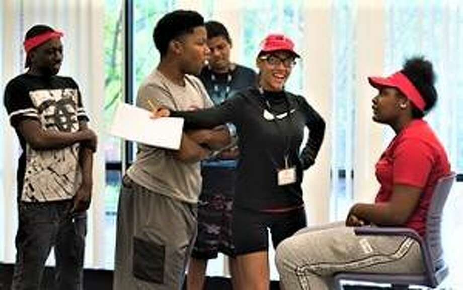 "SIUE East St. Louis Center Math and Science CM students perform ethnodramas on bullying: (in back) Montez Barber, Christian Williams and Kodi Courtland with ""teacher"" Khianna Wilkinson and Kennedy Bennett (seated). Photo:       For The Telegraph"