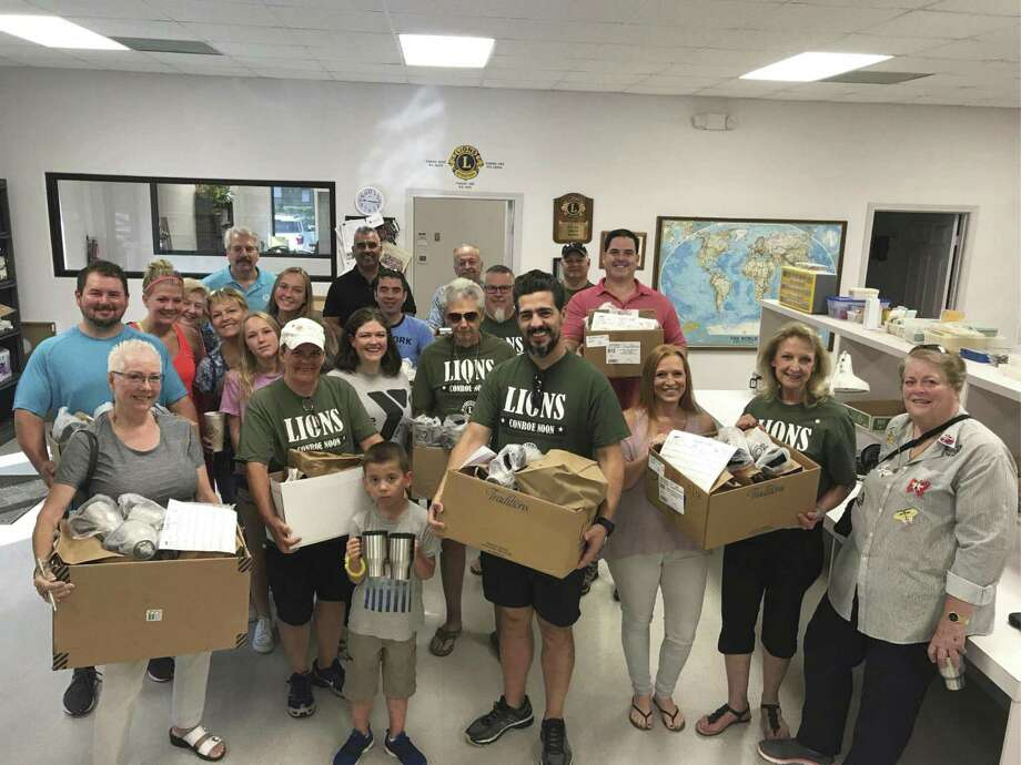 Conroe Noon Lions Club members delivered 'Breakfast Bags' for the Meals on Wheels program last week as part of the club's Service Saturdays projects.