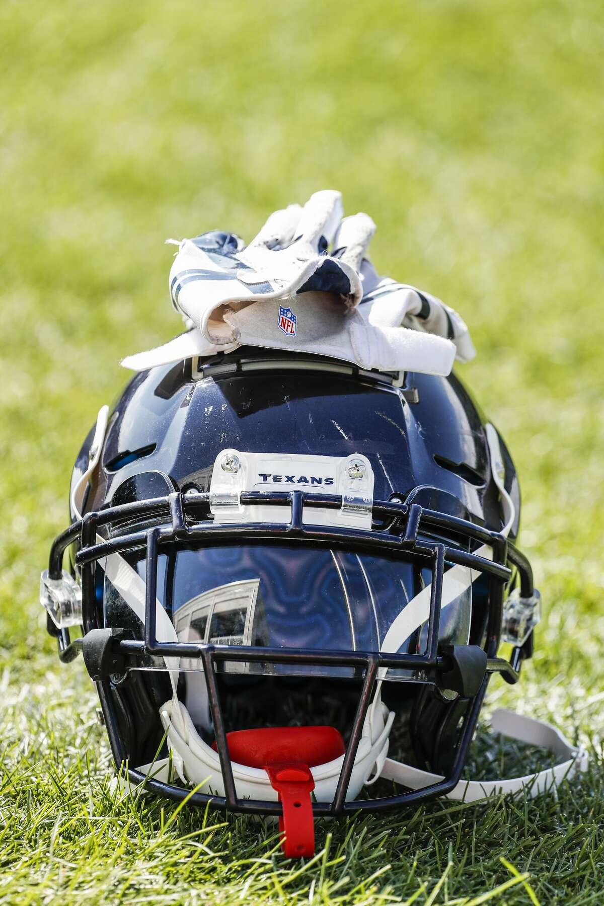 A Houston Texans helmet sits on the practice field during training camp at the Greenbrier Sports Performance Center on Sunday, July 29, 2018, in White Sulphur Springs, W.Va.