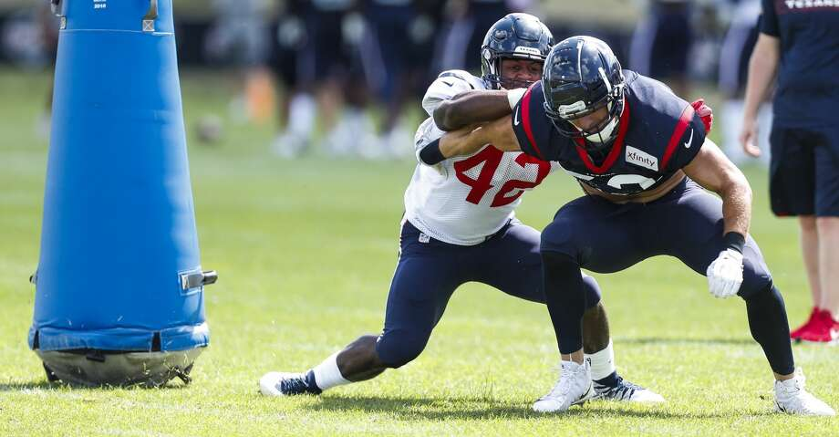 Houston Texans running back Terry Swanson (42) blocks linebacker Brian Peters (52) during training camp at the Greenbrier Sports Performance Center on Saturday, July 28, 2018, in White Sulphur Springs, W.Va. Photo: Brett Coomer/Houston Chronicle