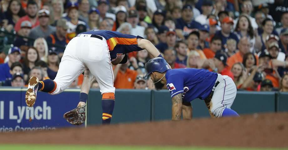 Houston Astros J.D. Davis (28) tries to field Texas Rangers Jurickson Profar's double allowing Texas Rangers Rougned Odor to score from third base during the sixth inning  of an MLB game at Minute Maid Park, Sunday, July 29, 2018, in Houston. Photo: Karen Warren/Houston Chronicle