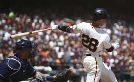 San Francisco Giants' Buster Posey connects for a three-run double off Milwaukee Brewers' Junior Guerra in the third inning of a baseball game Sunday, July 29, 2018, in San Francisco. (AP Photo/Ben Margot)