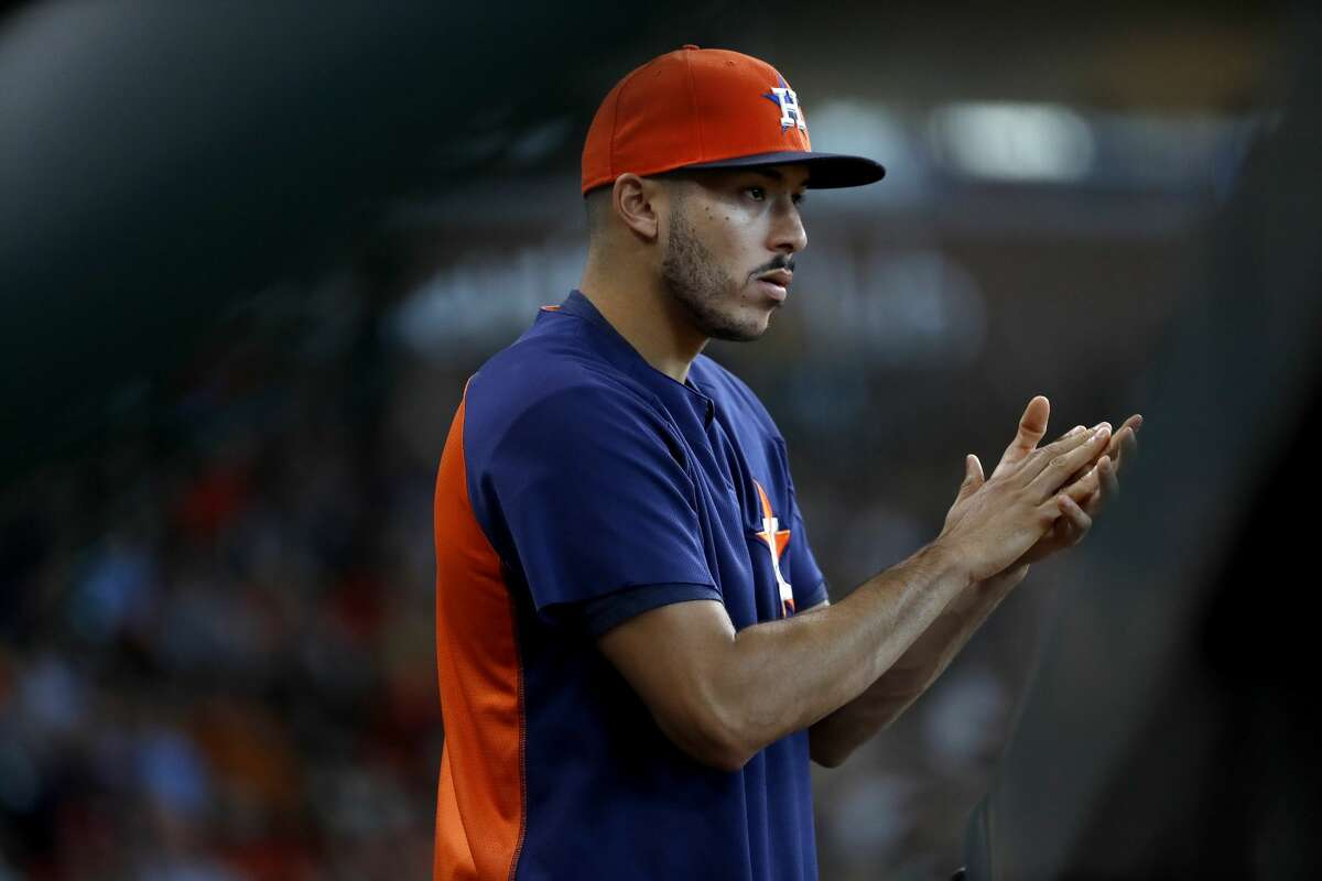 Houston Astros Carlos Correa cheers as Tony Kemp singled during the sixth inning of an MLB game at Minute Maid Park, Sunday, July 29, 2018, in Houston.