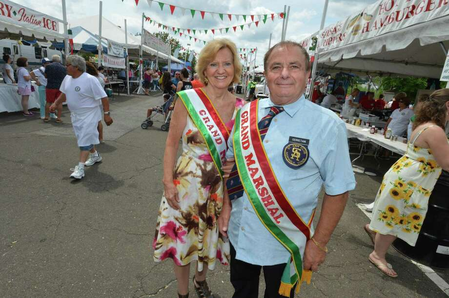Grand Marshal's Anna Marie and Walter Cerretani make their way through the festival during the last day of the St. Ann's Feast on Sunday July 29, 2018 in Norwalk Conn. Photo: Alex Von Kleydorff / Hearst Connecticut Media / Norwalk Hour