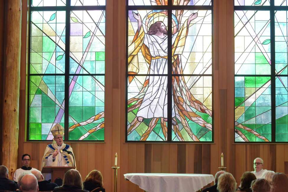Bishop Edward Scharfenberger addresses those gathered for a dedication of the new Mary Immaculate, Patroness of America at Most Holy Redeemer Cemetery Chapel Mausoleum on Thursday, Nov. 30, 2017, in Niskayuna, N.Y. The design of the mausoleum was done in the style of local architect and conservationist Paul Schaefer. The mausoleum has over 1,000 crypts and around 700 niches to hold cremation urns. (Paul Buckowski / Times Union)