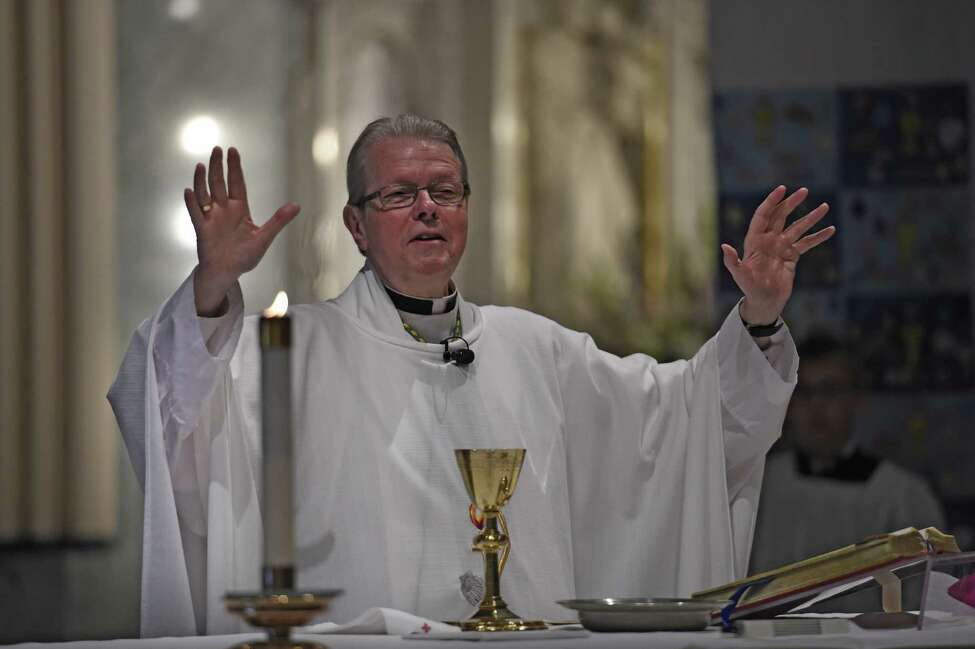 Bishop Edward Scharfenberger raises his hands in prayer during the Mass for St. Augustine's School June 3, 2016 in Troy, N.Y. (Skip Dickstein/Times Union) ORG XMIT: MER2016060314405224