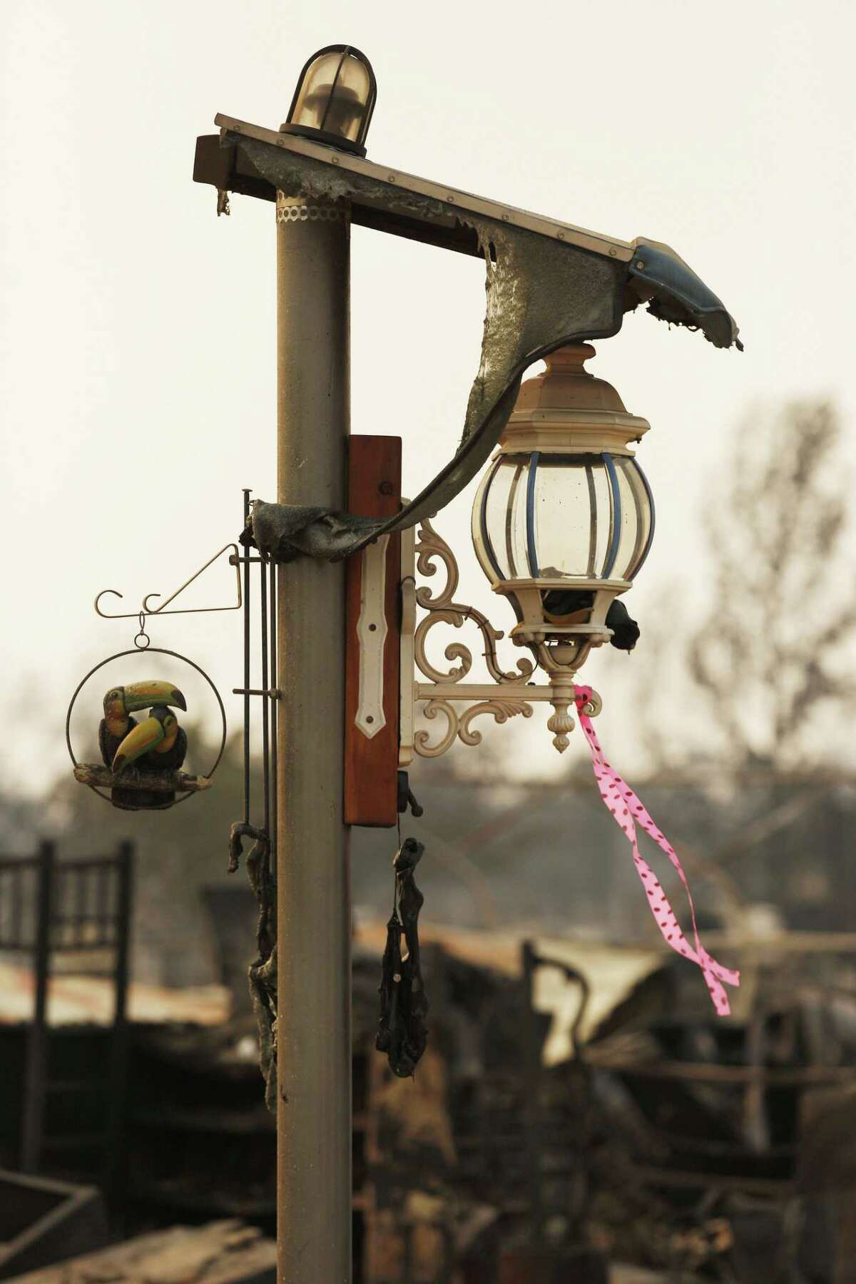 A lamppost stands at a destroyed home along Puffin Way off of Cape Cod Drive in Redding.