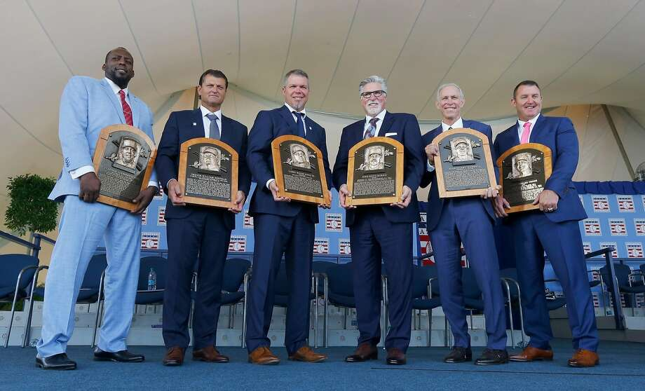 New Hall of Famers Vladimir Guerrero, Trevor Hoffman, Chipper Jones, Jack Morris, Alan Trammell and Jim Thome show off their new plaques in Cooperstown, N.Y. Photo: Jim McIsaac / Getty Images