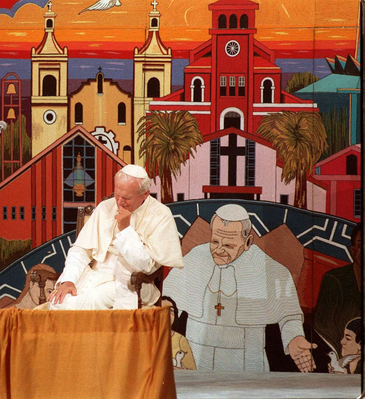 Pope John Paul II prays in front of a crowd at Guadalupe Plaza on Sept 13, 1987, during his visit to San Antonio.