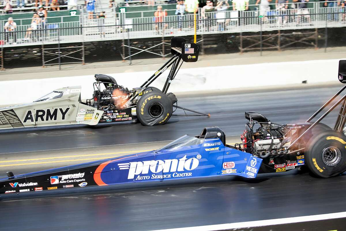 Blake Alexander, right, overtakes Tony Schumacher in the championship heat of the Top Fuel competition of the Toyota NHRA Sonoma Nationals at Sonoma Raceway, on Sunday, July 29, 2018 in Sonoma, Calif.