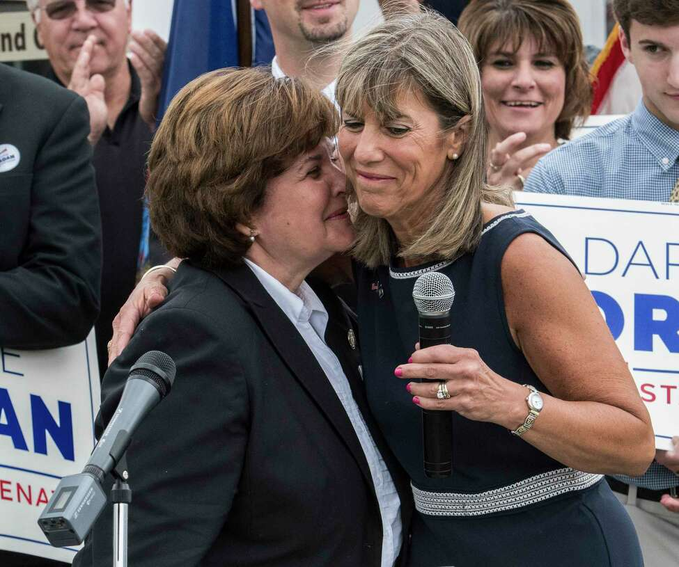 Senator Kathy Marchione, left gives a kiss to Daphne Jordan who she introduced as her replacement in the State Senate at Jordan's announcement of her intention to run for Marchiones' seat Thursday July 26, 2018 at Hayner's Food and Ice-cream shop in Halfmoon, N.Y. (Skip Dickstein/Times Union)