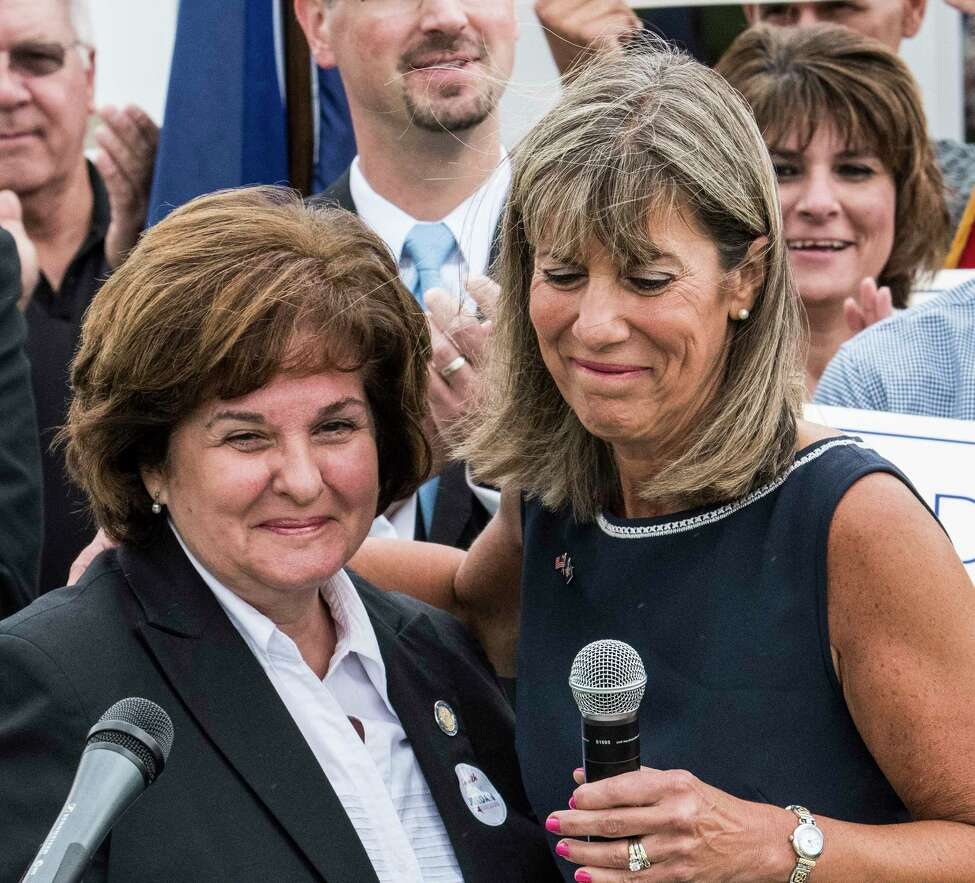 Senator Kathy Marchione, left, hugs Daphne Jordan who she introduced as her replacement in the State Senate at Jordan's announcement of her intention to run for Marchiones' seat Thursday July 26, 2018 at Hayner's Food and Ice-cream shop in Halfmoon, N.Y. (Skip Dickstein/Times Union)