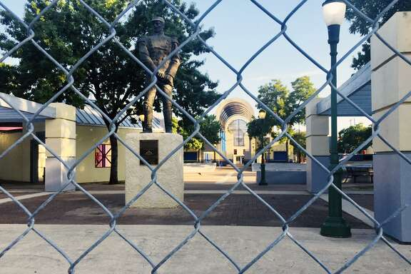 The 6-foot chain-link fence that surrounds Guadalupe Plaza was installed two-years ago. Behind the fence and pictured in the background the plaza's playground sits unused.