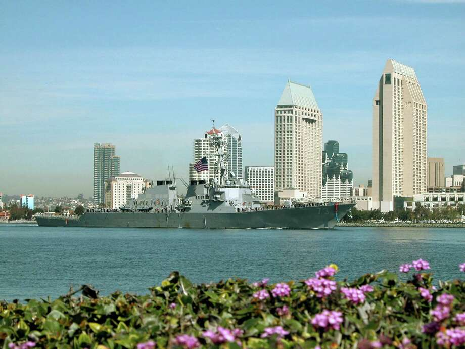 040309-N-7949W-002 CORONADO, Calif. (MAR 9, 2004) Ð USS Decatur (DDG 73) sails past downtown San Diego on the way to loved ones waiting pier side at Naval Base San Diego.  Decatur is part of the NavyOs first ESG (Expeditionary Strike Group) that consists of Decatur, five other ships and one submarine.  ESG1 was deployed in support of Operation Iraqi Freedom and the Global War on Terrorism. U.S. Navy photo by PhotographerOs Mate 1st Class Daniel N. Woods (RELEASED) Photo: PH1 Daniel N. Woods / Navy Visual News Service