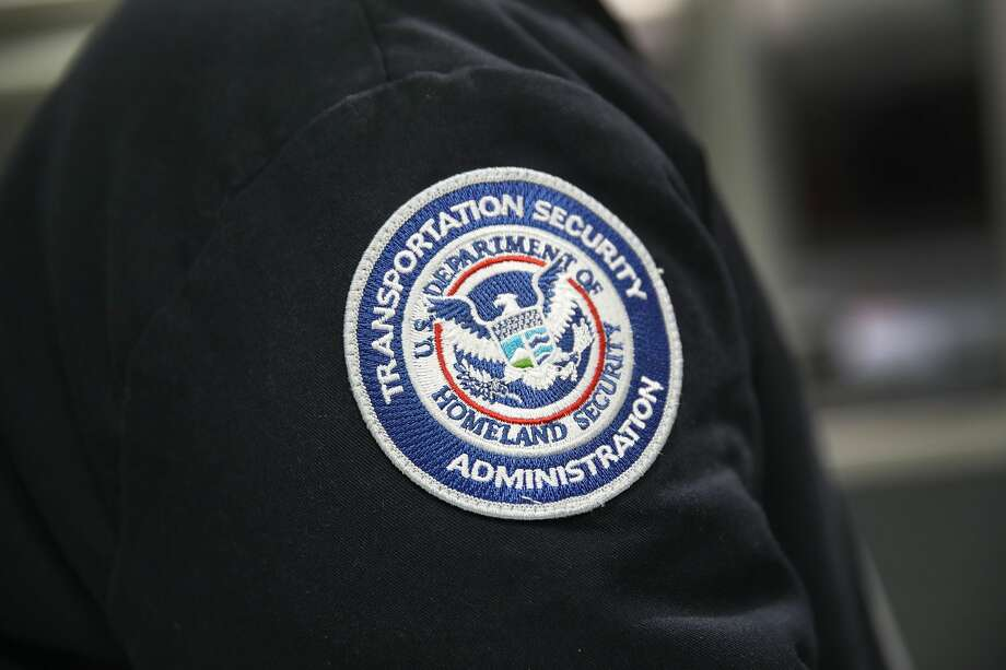 A patch is seen on the jacket of a Transportation Security Administration official as he works at the automated screening lanes funded by American Airlines and installed by the Transportation Security Administration at Miami International Airport on October 24, 2017 in Miami, Florida.  Photo: Joe Raedle/Getty Images