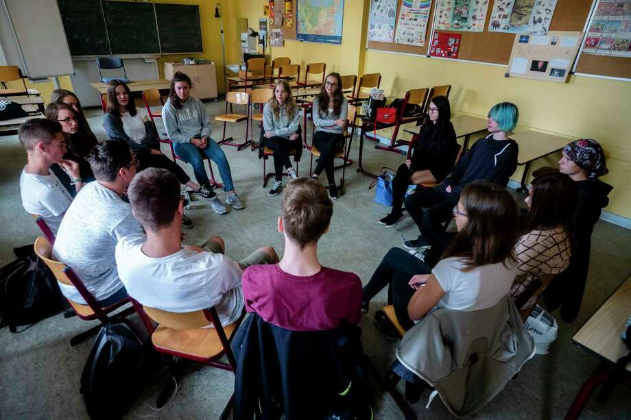 In this Monday, June 25, 2018, photo, Laura Schulmann, center right, and Sophie Steiert, center left, listen to questions from students about Jewish daily life in Germany during a lesson as part of a project about religions at the Bohnstedt Gymnasium high school in Luckau, Germany.  Photo: Markus Schreiber / Copyright 2018 The Associated Press. All rights reserved.