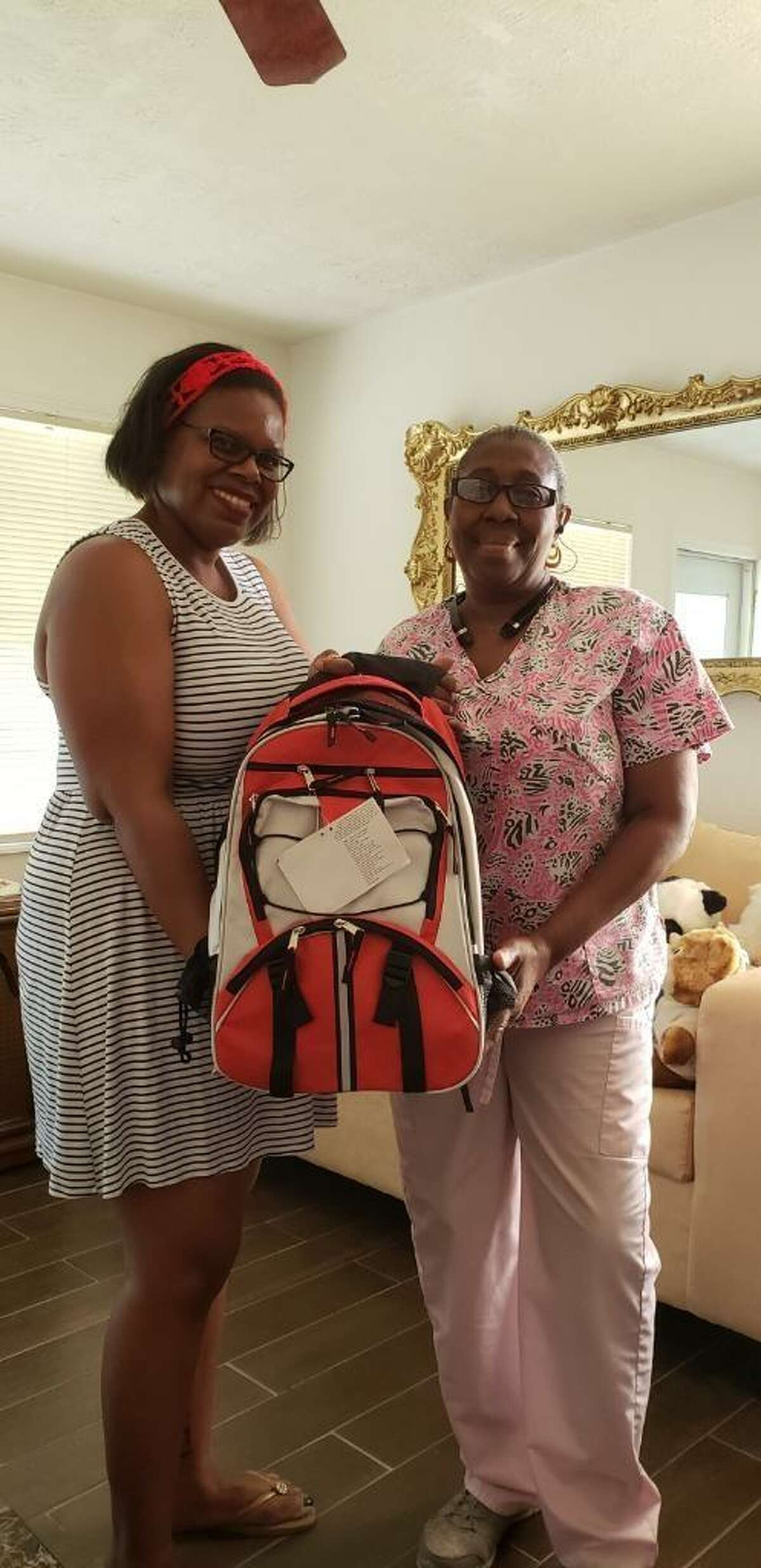 Deanna Adams and Jackie White posing on Saturday, July 28. Adams, of West Street Recovery, dropped off a disaster bag to White, whose home was devastated in Hurricane Harvey.