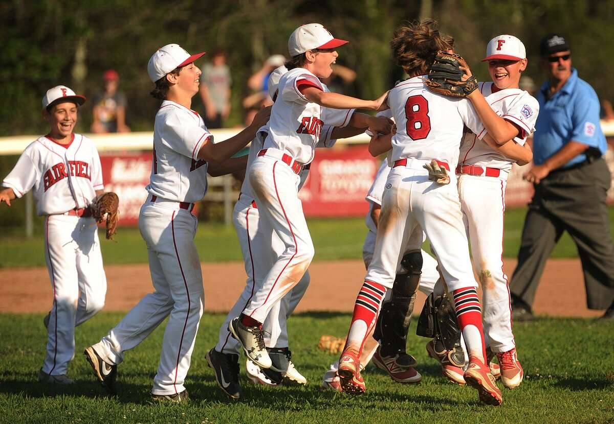 Fairfield American players celebrate on the infield after defeating Manchester National 11-9 to win the Little League State Championship at President's Field in East Lyme on Sunday.