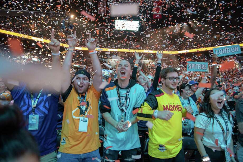 London Spitfire fans celebrate after the team triumphed over the Philadelphia merger at the inaugural Overwatch League Grand Finals at the Barclays Center. Photo: Photo for the Washington Post By David
