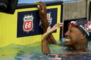 Simone Manuel celebrates after winning the women's 50-meter freestyle final at the U.S. national championships swimming meet, Sunday, July 29, 2018, in Irvine, Calif. (AP Photo/Chris Carlson)