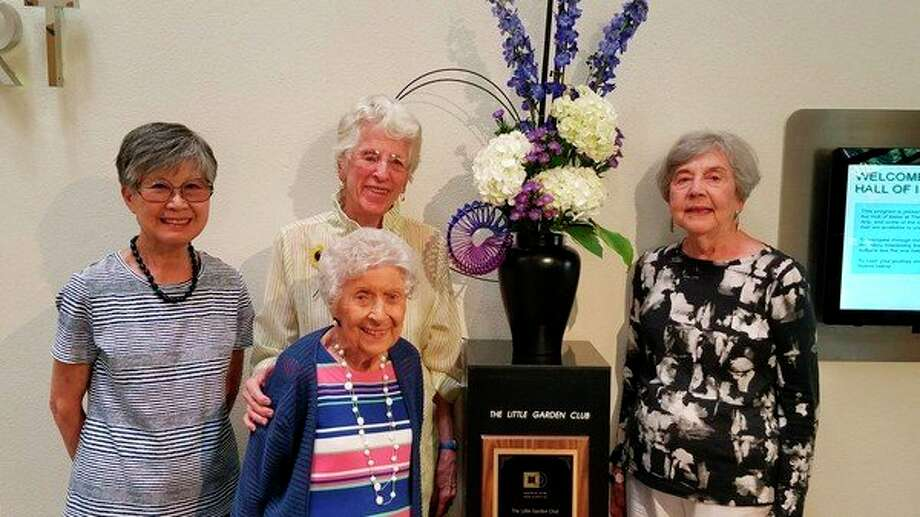 Members of The Little Garden Club are, from left: Yoshie Ziarro, Pat Smith, Rhea Currie (foreground) and Christine Lane at the Midland Center for the Arts.