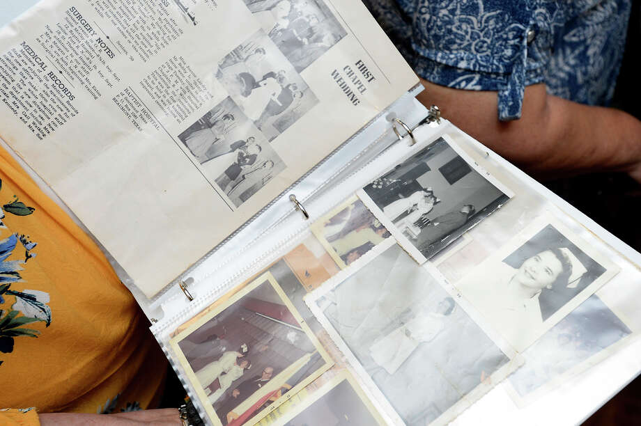 Karen Ascol shows a scrapbook during a reunion of former students from the Baptist Hospital School of Professional Nursing. The school closed in 1974. Photo taken Friday 7/27/18 Ryan Pelham/The Enterprise Photo: Ryan Pelham/The Enterprise / ?2018 The Beaumont Enterprise
