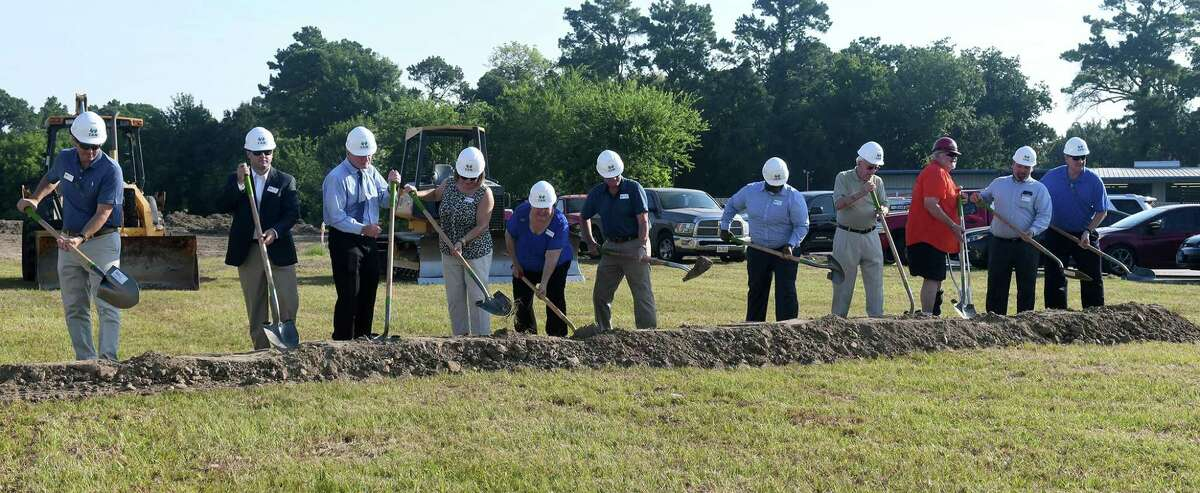 A groundbreaking ceremony for a new Cypress Assistance Ministries (CAM) building, including Frank Angelle, from left, Chair & CAM Board of Directors (BoD), William Rose, CAM Bod Treasurer, Dr. Tom DeBauche, Cyndy Zolfo, Martha Barnes, CAM Executive Director, Jim Rambousek, CAM BoD President, Kerry Williams CAM BoD, Harry McGraw, Construction Consultant, Builder Robert Scherer, SCS Construction Management, Marty Weidemann, CAM BoD, and Jim Prewitt, Community Volunteer, was held in a lot adjacent to 12920 Cypress N. Houston Road in Cypress on July 25, 2018.