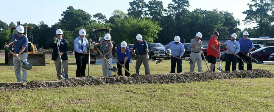 A groundbreaking ceremony for a new Cypress Assistance Ministries (CAM) building, including Frank Angelle, from left, Chair & CAM Board of Directors (BoD), William Rose, CAM Bod Treasurer, Dr. Tom DeBauche, Cyndy Zolfo, Martha Barnes, CAM Executive Director, Jim Rambousek, CAM BoD President, Kerry Williams CAM BoD, Harry McGraw, Construction Consultant, Builder Robert Scherer, SCS Construction Management, Marty Weidemann, CAM BoD, and Jim Prewitt, Community Volunteer, was held in a lot adjacent to 12920 Cypress N. Houston Road in Cypress on July 25, 2018. Photo: Jerry Baker, Contributor / Houston Chronicle / Houston Chronicle