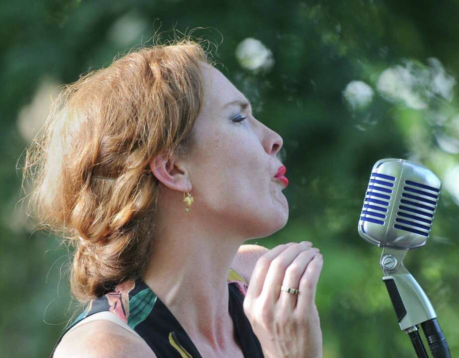 Vocalist Stephanie Layton sings during Eden Lane's performance as part of the Friends of Greenwich Point concert series at Greenwich Point Park's Seaside Garden in Old Greenwich, Conn. Sunday, July 29, 2018. NYC-based jazz band Eden Lane, led by vocalist Stephanie Layton, performed standards from the Great American Songbook and Prohibition-era classics before a large crowd overlooking the sunset at Tod's Point. Photo: Tyler Sizemore / Hearst Connecticut Media / Greenwich Time