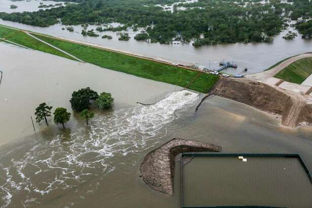Water is released from the Barker Reservoir in the aftermath of Hurricane Harvey on Tuesday, Aug. 29, 2017, in Houston.