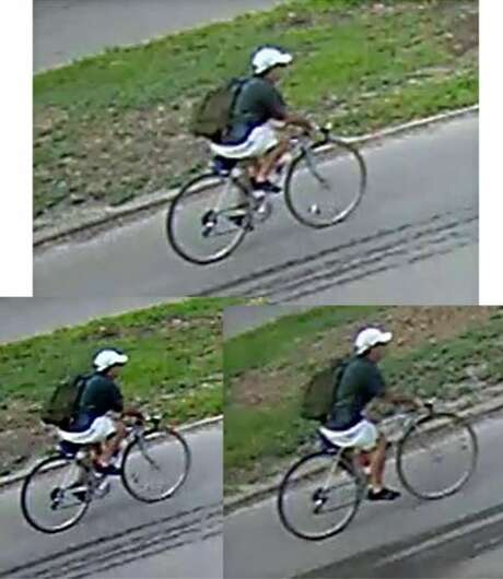 Houston police on July 30, 2018 released photos of the suspect wanted in the July 20 killing of Dr. Mark Hausknecht. The suspect is seen biking through an area neighborhood in the latest photos. Photo: Houston Police Department