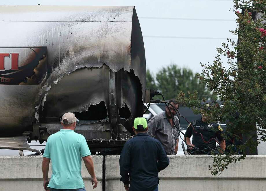A hole could could be seen from the side of an 18-wheeler caught on Interstate Highway 10 eastbound near Park Ten Boulevard on Monday, July 30, 2018, in Houston. At one point all mainlanes were affected, according to Houston TranStar. Photo: Yi-Chin Lee, Houston Chronicle / © 2018 Houston Chronicle
