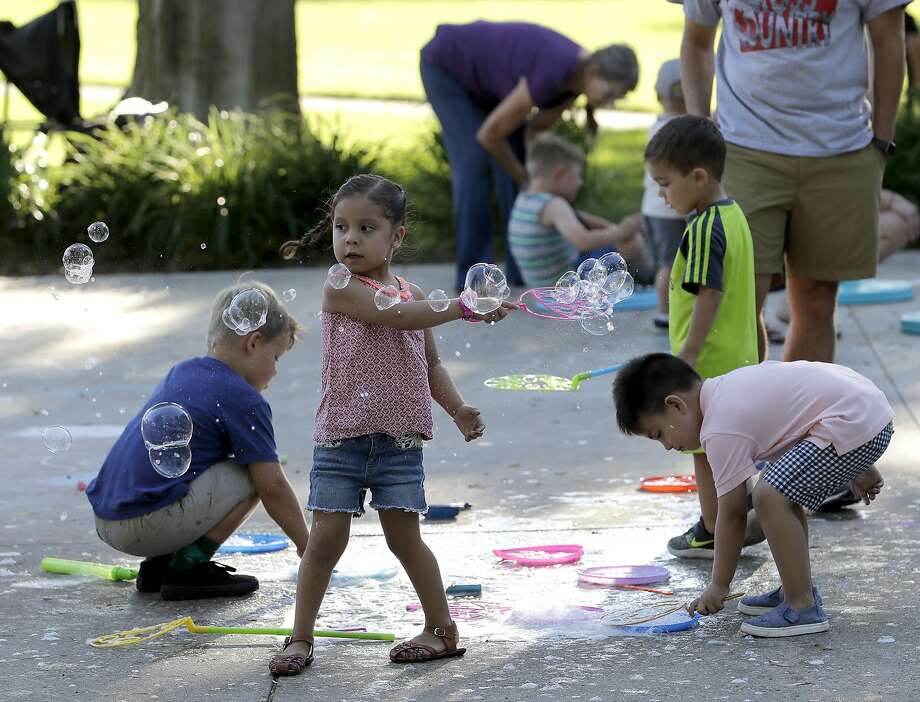 Children play on the grounds of the Elkhart County, Indiana Courthouse during the monthly First Fridays street festival on June 1, 2018. Attendance at the street festival reflects the county's growing racial and ethnic diversity. (AP Photo/Charles Rex Arbogast) Photo: Charles Rex Arbogast / Associated Press