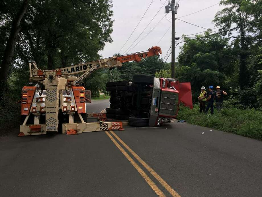 Plumtrees Road was closed for several hours Monday after a dump truck rolled onto its side Photo: / Contributed