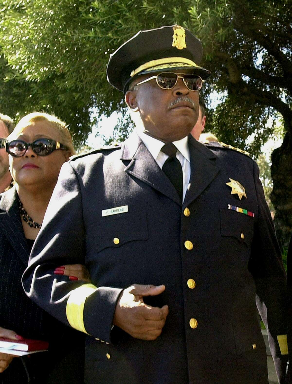San Francisco Police Chief Earl Sanders and his wife, Espanola Sanders, appear at the San Francisco Hall of Justice Tuesday, March 4, 2003.