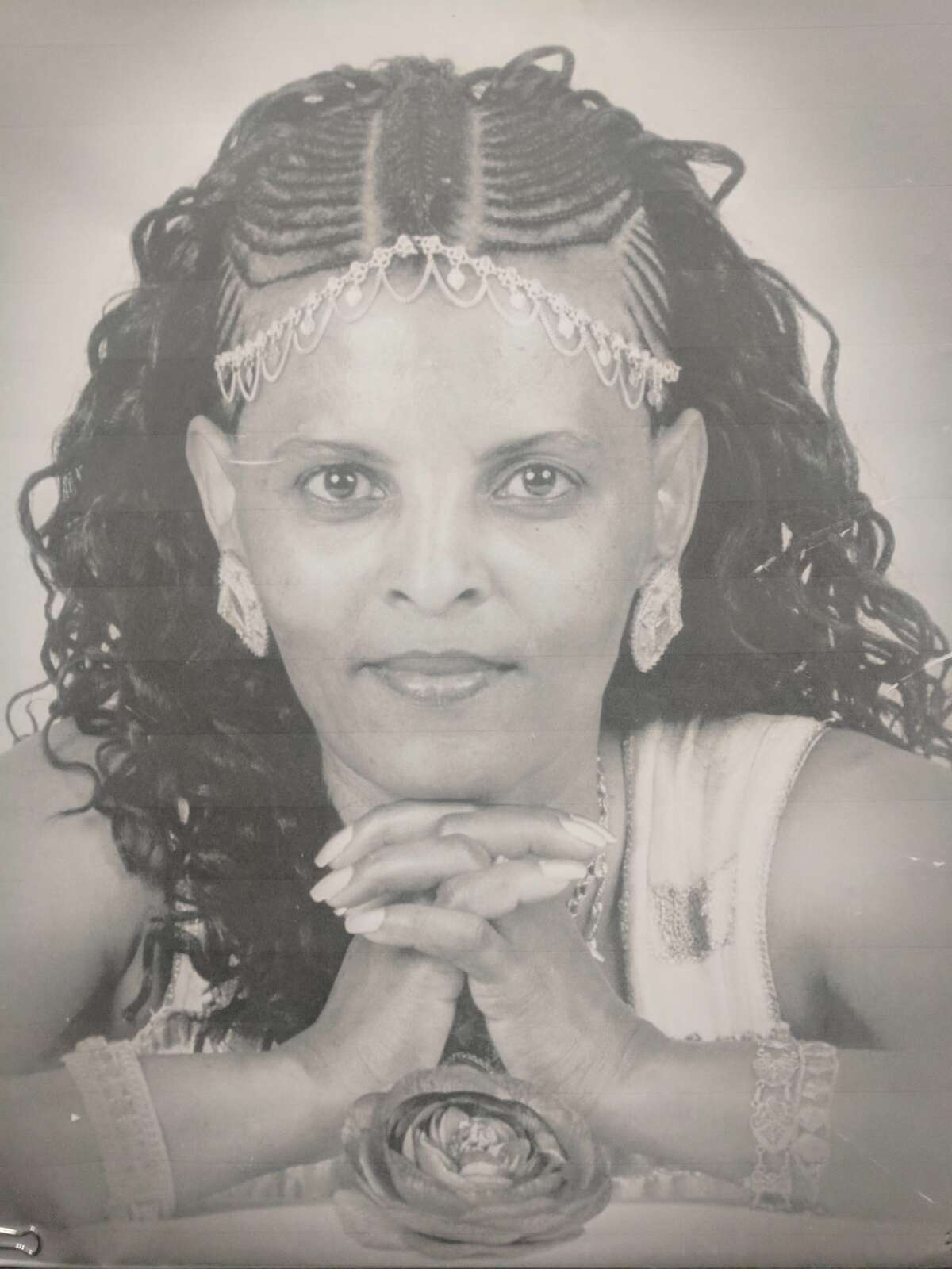 Tringo Ferede-Tesema's family posted photos of her at the sentencing of her husband, Aregay Tesfamariam, Friday in King County Superior Court in Kent. Tesfamariam fatally stabbed Ferede-Tesema in August 2017 at their Kent home, in front of their adult son and a passing mailman.