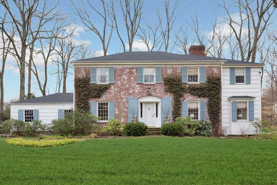 The elegant brick and wood colonial house at 10 Haskell Lane sits on a 1.07-acre level property at the end of a cul-de-sac, withing walking distance of the train station and schools.