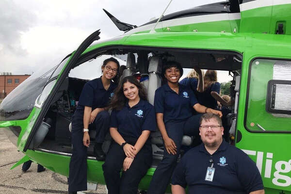 A visit from Life Flight to the Miller Career & Technology Center is part of the EMT program offered by Katy Independent School District. Course coordinator David Watson poses for a photo with students.