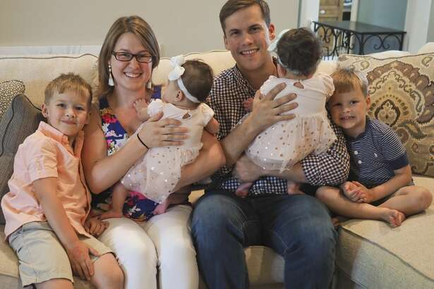 Bonnie and Tyler West, with their sons, Carter and Gavin, and their foster twin babies.