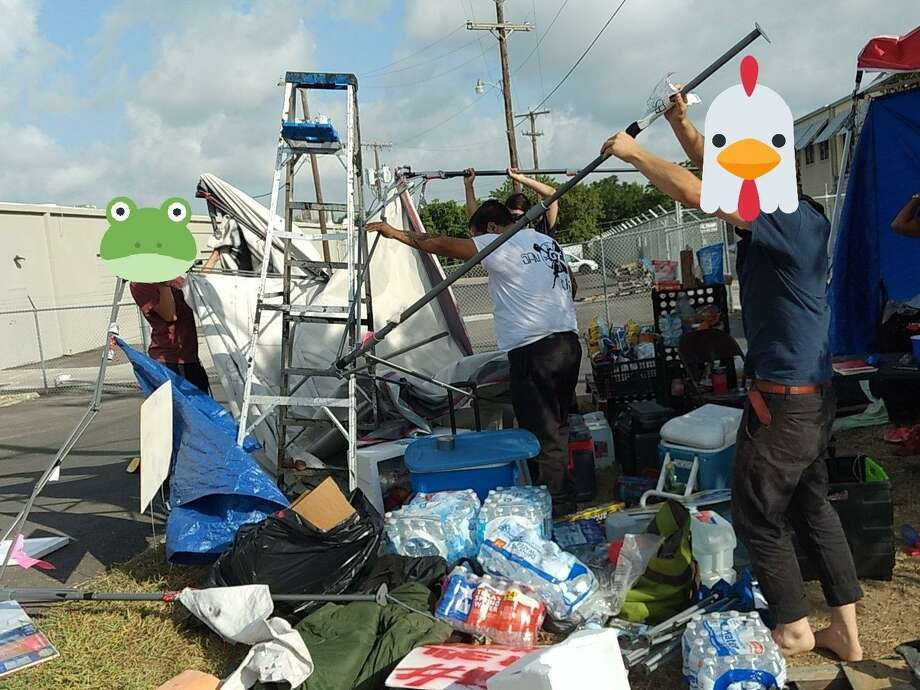 Members of Occupy ICE SATX reassemble their camp outside a northeast ICE facility after parts of it were reportedly knocked down by members of Patriot Front. The faces of members were obscured by the group for fear that identification would enable retaliation by members of Patriot Front. Photo: Courtesy Of Occupy ICE SATX /