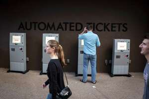 A man uses his MoviePass at the automated ticket kiosks at AMC Disney Springs 24 theater, near Orlando, Fla., Dec. 26, 2017. MoviePass, which experienced a service outage on July 26, 2018, was forced to borrow $5 million after it reported it could not pay its bills, raising new questions about the subscription-based movie ticket services viability.