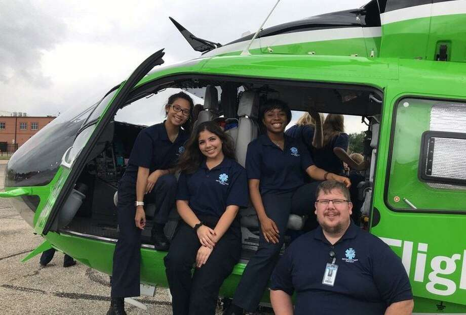 A visit from Lifeflight to the Miller Career & Technology Center is part of the EMT program offered by Katy Independent School District. Course coordinator David Watson poses for a photo with students. Photo: Katy ISD / Katy ISD