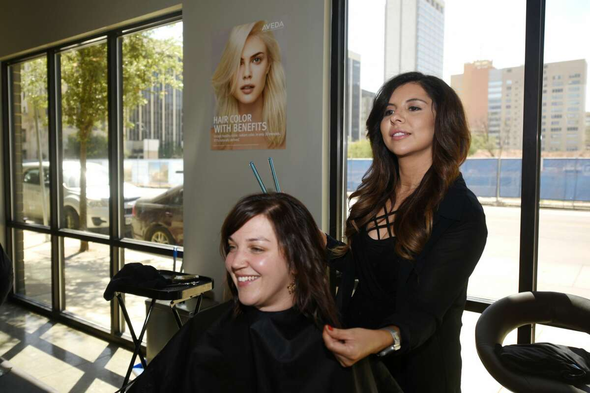 Chrissy Hale, owner of Halo Hair and Beauty Bar, works with Katie Jerath on April 7.