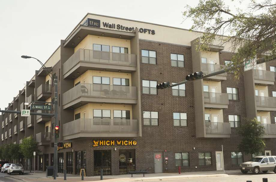 The Wall Street Lofts is leading the way in downtown revitalization. Its 108 apartments are all occupied and there are two businesses on the ground floor: Which Wich, a sandwich shop, and Halo, a hair salon. Photo: Tim Fischer/Midland Reporter-Telegram