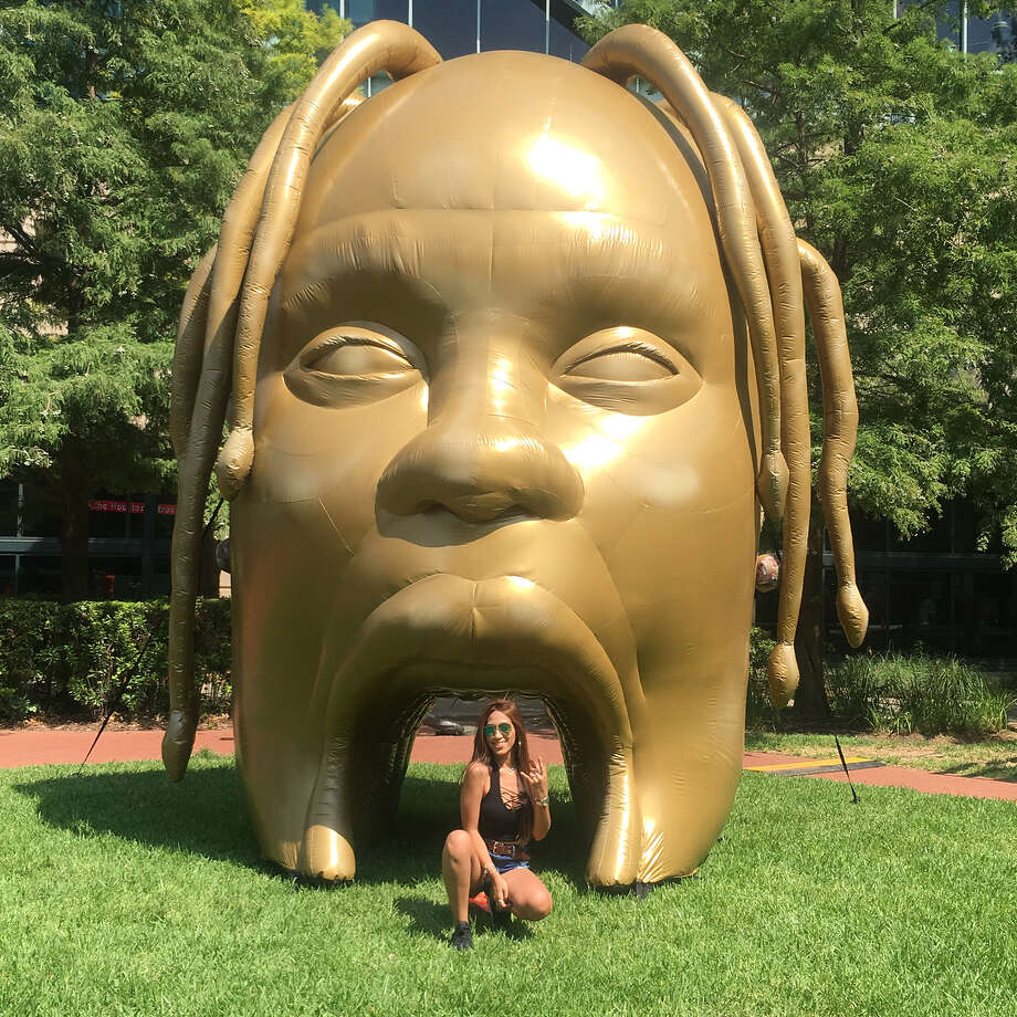 Fan @glamdollsteph poses with the Travis Scott head outside Minute Maid Park in Houston over the weekend. Photo: Instagram.com/glamdollsteph